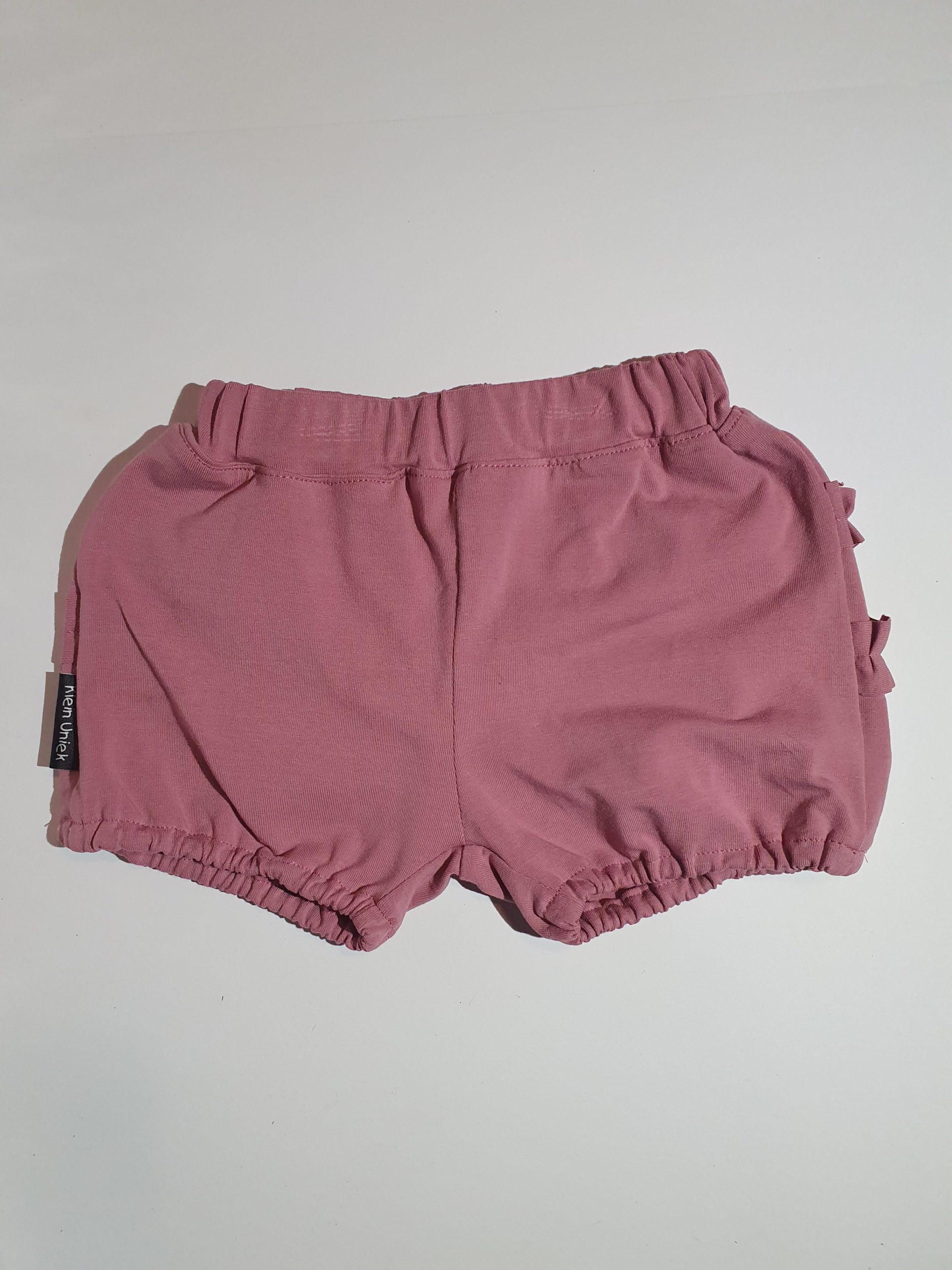 Korte broek, oudroze met ruffle…